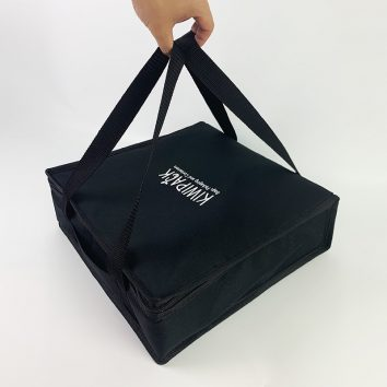 pizza bag being held by hand