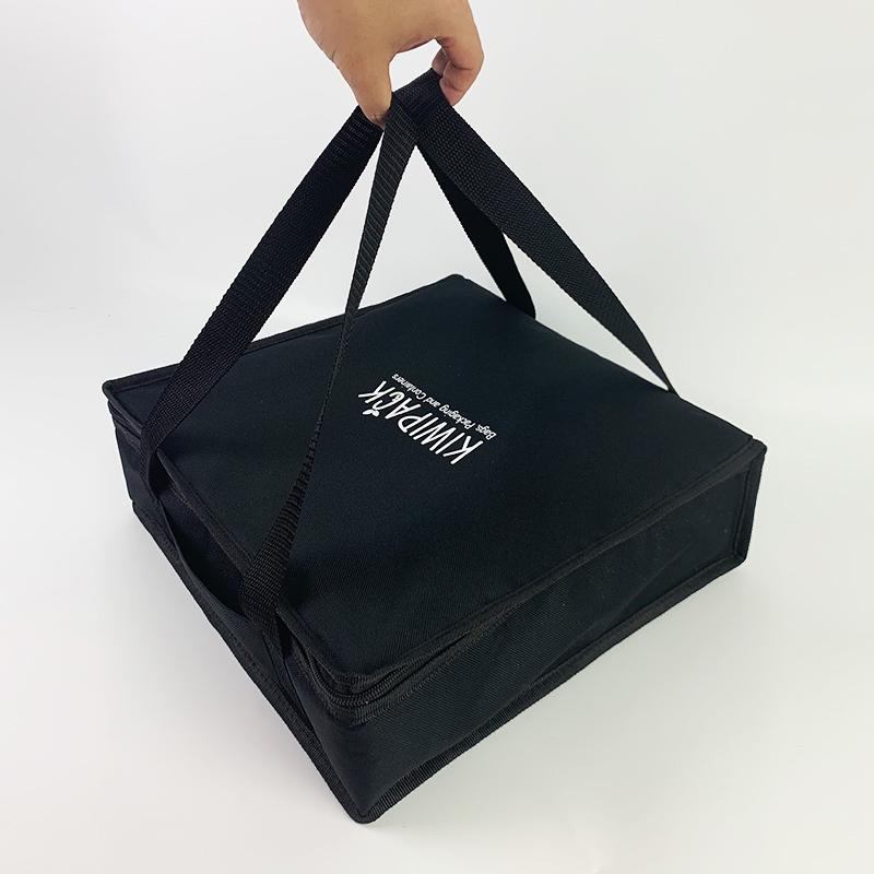 pizza bag being held